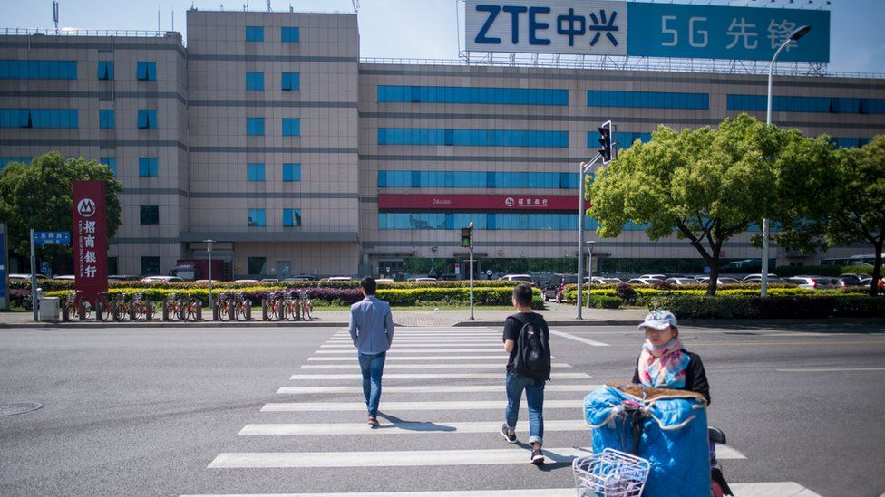 his picture taken on May 3, 2018 shows the ZTE logo on an office building in Shanghai. - Chinese telecom giant ZTE said its major operations had 'ceased' following last month's US ban on American sales of critical technology to the company, raising the possibility of its collapse.