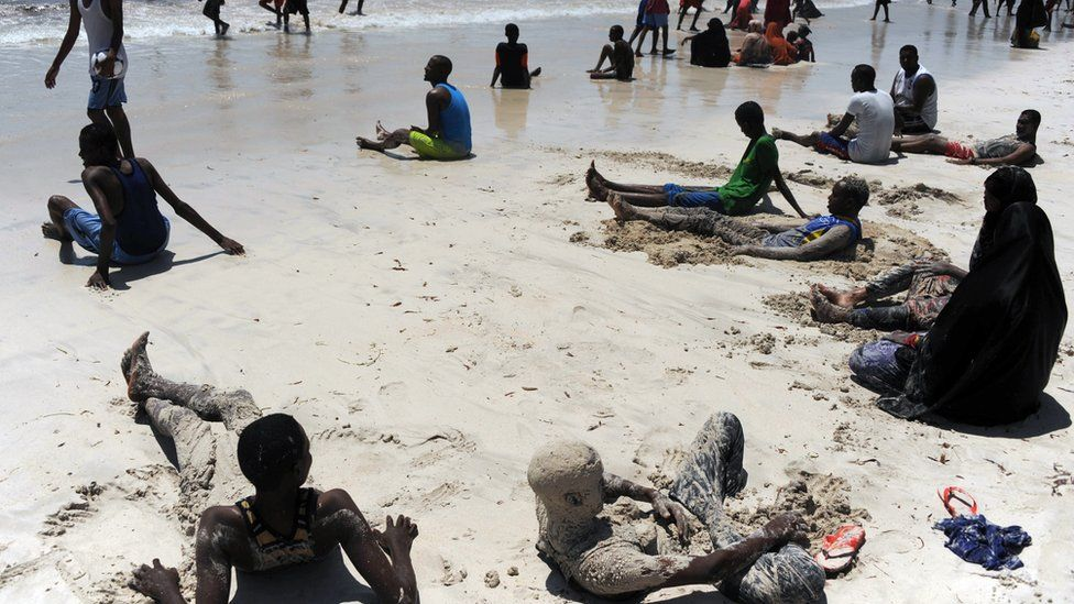 Residents relax on Lido beach on October 31, 2014 along the Indian Ocean's coastal city of Mogadishu