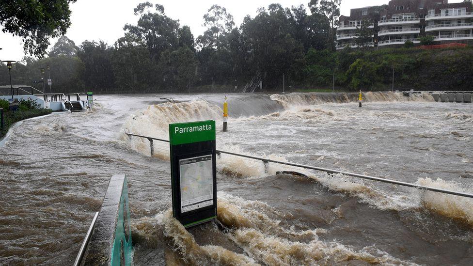 Parramatta River flooding the ferry wharf in Parramatta