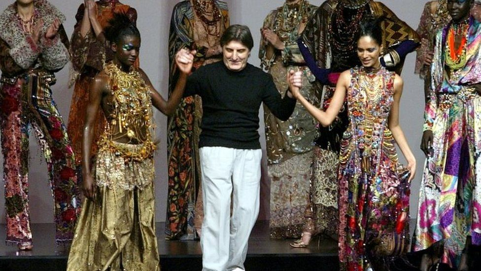 French designer Emanuel Ungaro appears with his models at the end of his Autumn-Winter 2002-2003 high fashion collection
