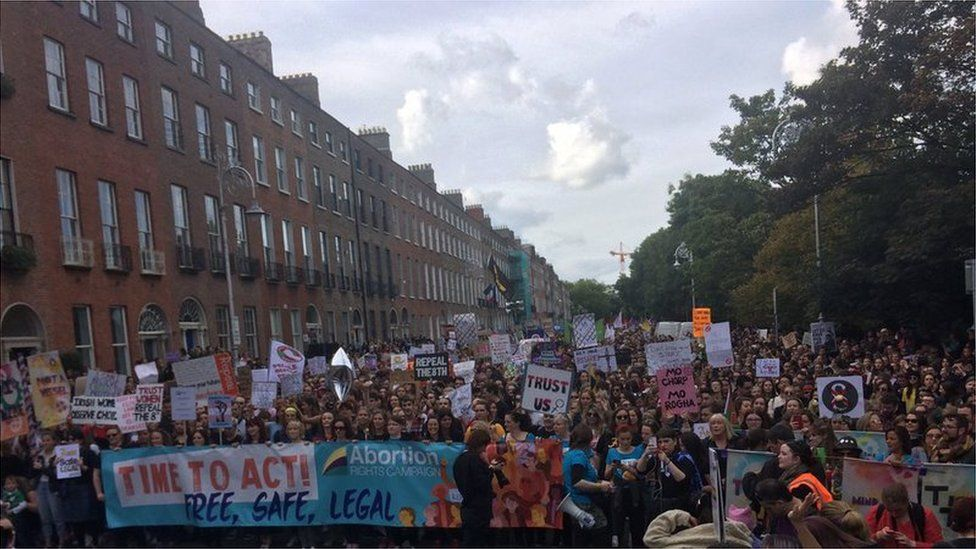 People marching through Dublin