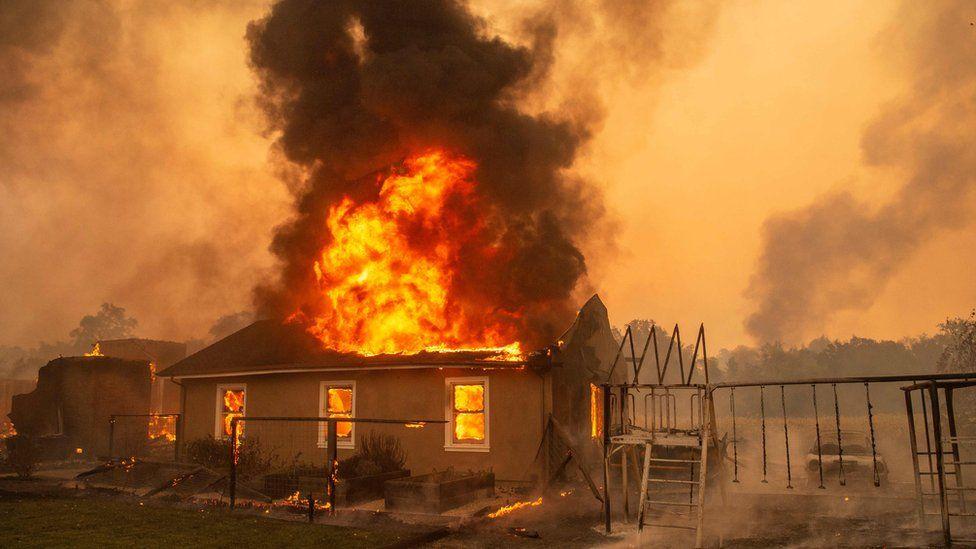 A home burns at a vineyard during the Kincade fire near Geyserville, California