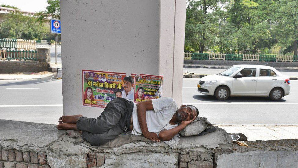 A homeless man takes an afternoon nap under a flyover on a hot day near Nigambodh Ghat as temperature rises above 45 degree celsius, on June 2, 2019.