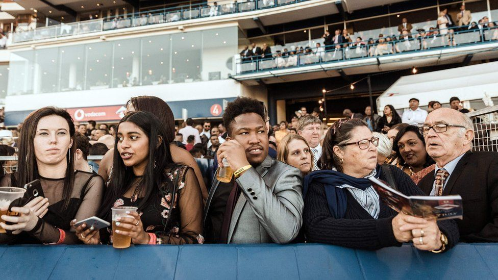 People watch the start of the 2018 editon of the Vodacom Durban July horse race in Durban, on 7 July 2018