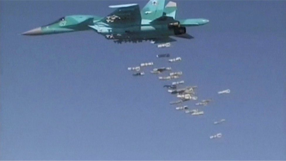 A still image, taken from video footage and released by Russia's Defence Ministry 18 August 18 2016, shows a Russian Sukhoi Su-34 fighter-bomber based at Iran's Hamadan air base, dropping off bombs in the Syrian province of Deir ez-Zor.