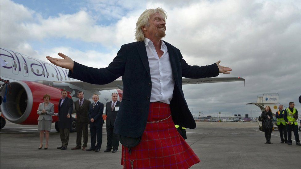 Sir Richard Branson arrives in Edinburgh Airport on April 8, 2013 in Edinburgh, Scotland. He arrived aboard the inaugural Virgin Atlantic Little Red flight.
