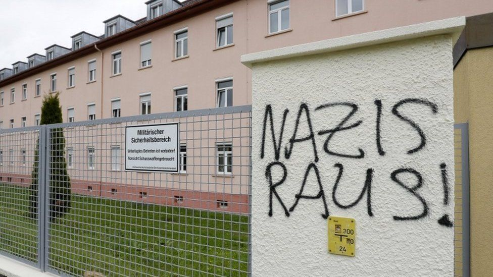 """Letters reading """"Nazis Raus!"""" (Nazis out!) on a fence near the main gate of the Fuerstenberg barracks in Donaueschingen, Germany, 07 May 2017."""