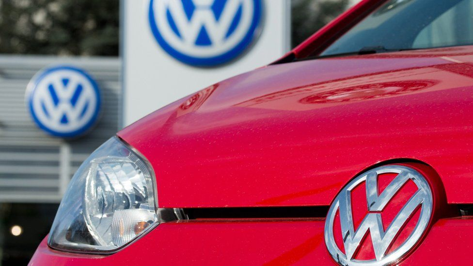 A red Volkswagen in front of a car dealer in Hanover, Germany