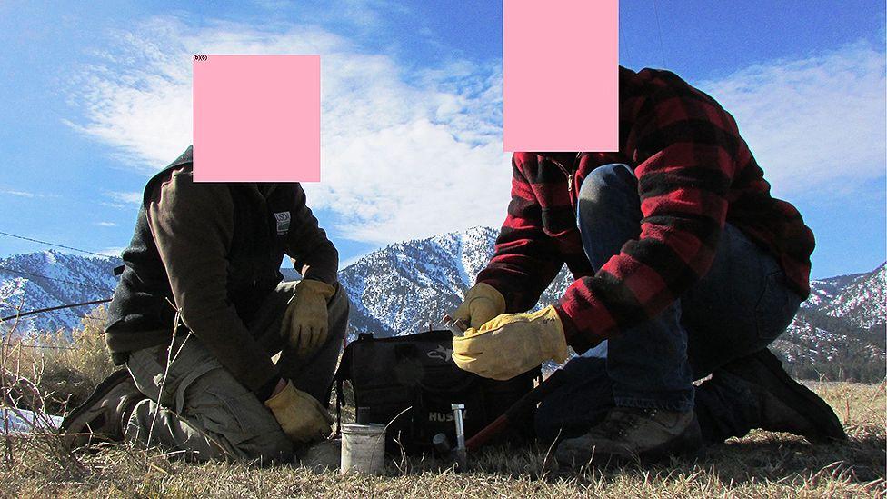 Two men setting a trap