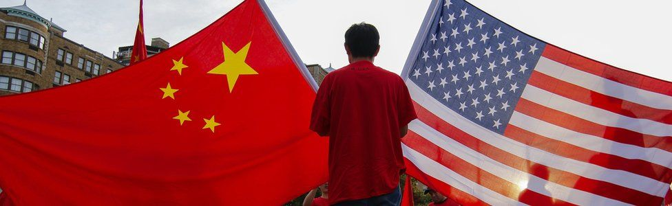 A protester with Chinese and US flags in Washington DC