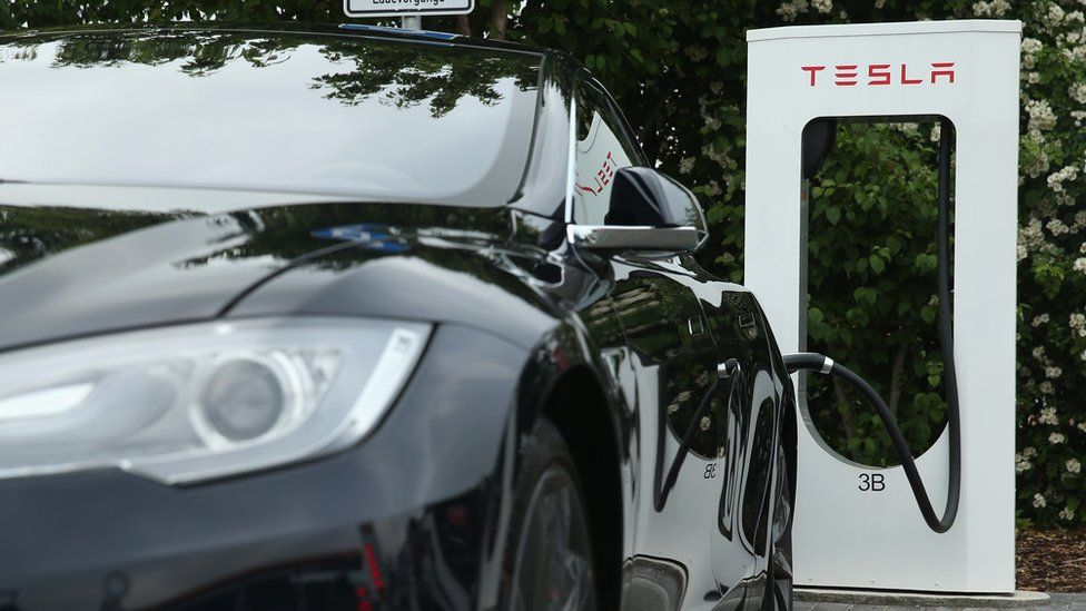 Tesla charging station with car