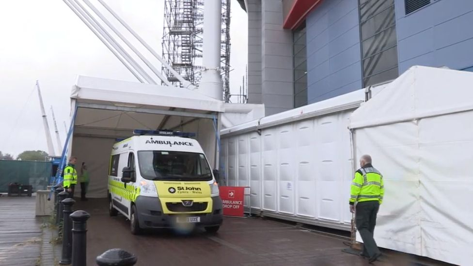 An ambulance arriving at the Dragon's Heart field hospital at the Principality Stadium
