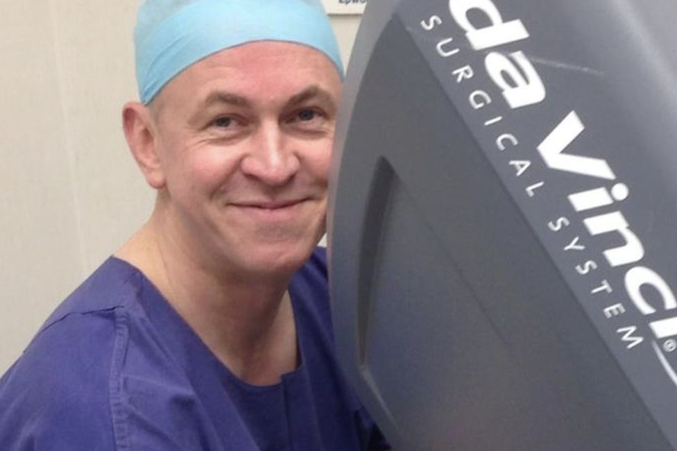 Ken Linton at the controls of a surgical robot