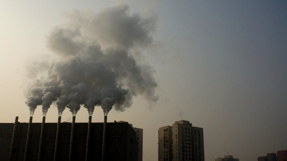 Factory chimneys giving off smoke in Beijing, China