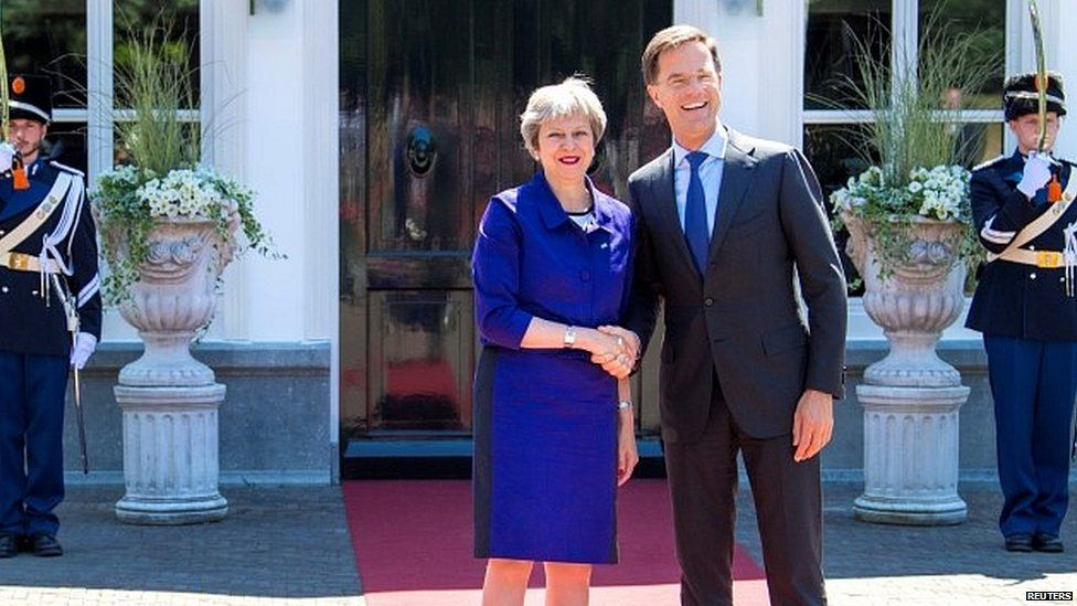Theresa May meeting her Dutch counterpart in The Hague