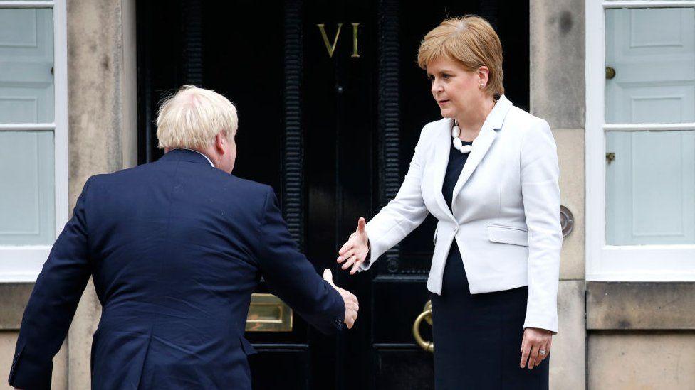 Boris Johnson about to shake hands with Nicola Sturgeon