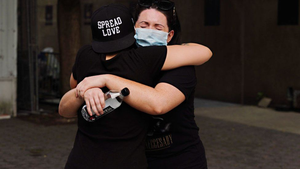 People embrace during the coronavirus pandemic on May 29, 2020 in New York City