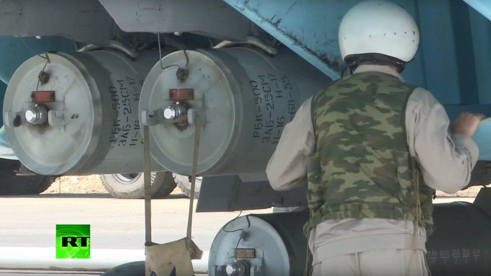 soldier with warplane and two large metal barrels