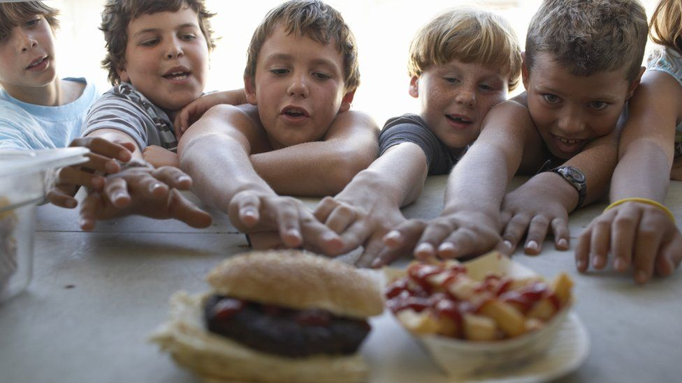 children reaching for fastfood