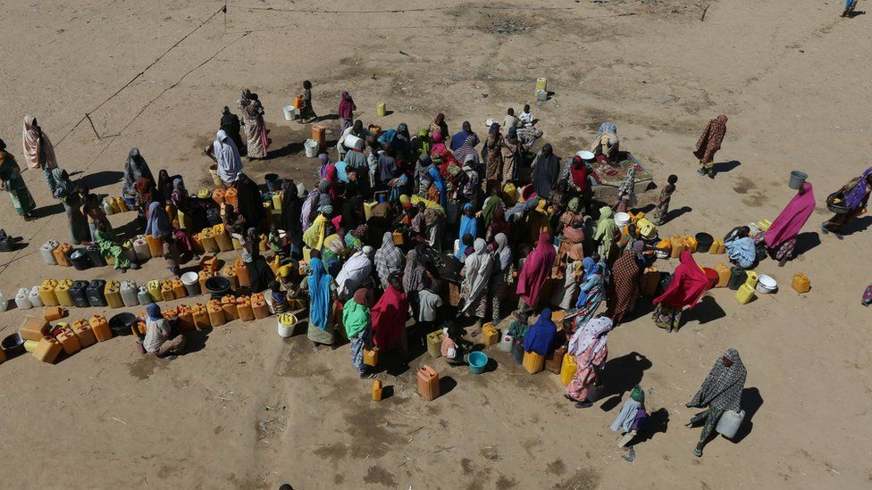 Women and children are seen gathered at the water point at the internally displaced peoples camp Muna camp in Maiduguri, Nigeria, December 1, 2016.