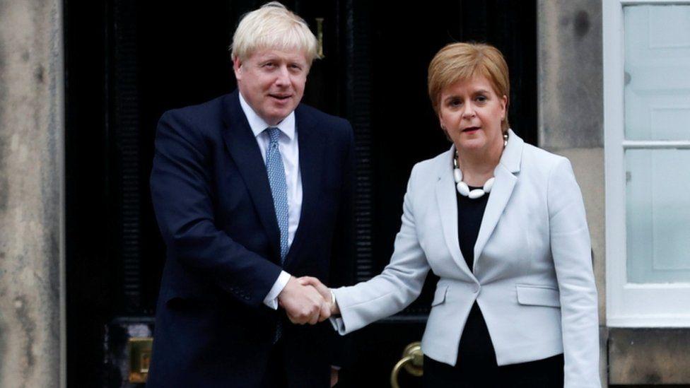 Nicola Sturgeon and Boris Johnson outside Bute House