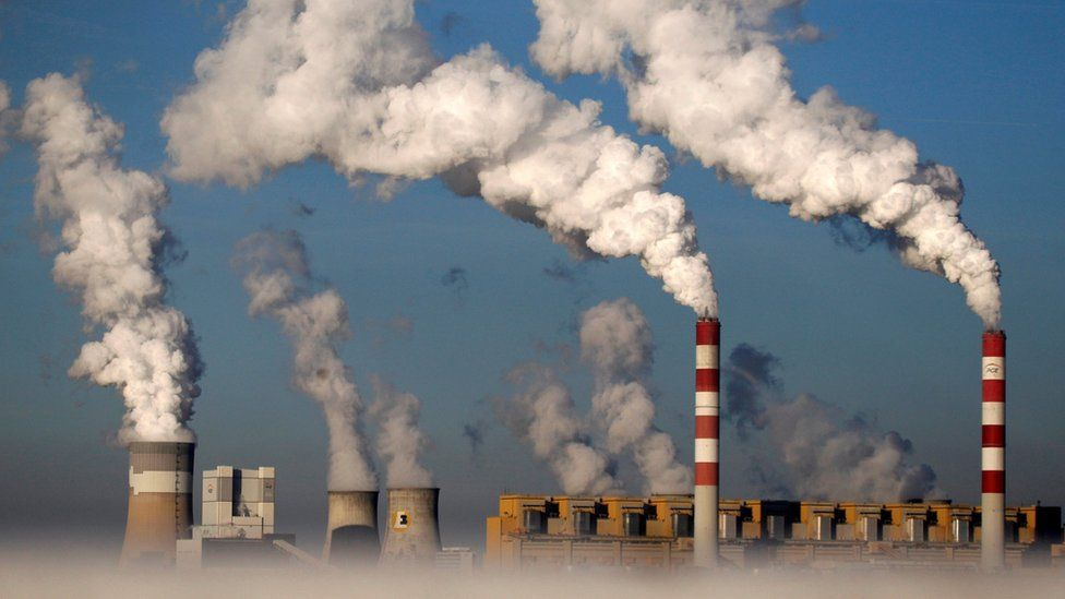 Smoke billows from chimneys at a power station in Belchatow, Poland