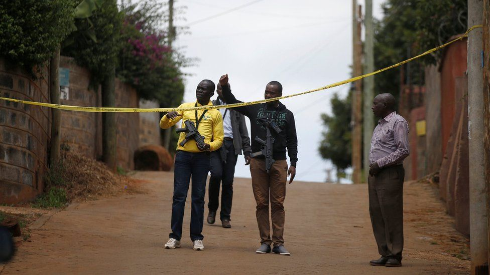 Police stand guard outside the home of one of the suspects in Kiambu county, on 16 January 2019