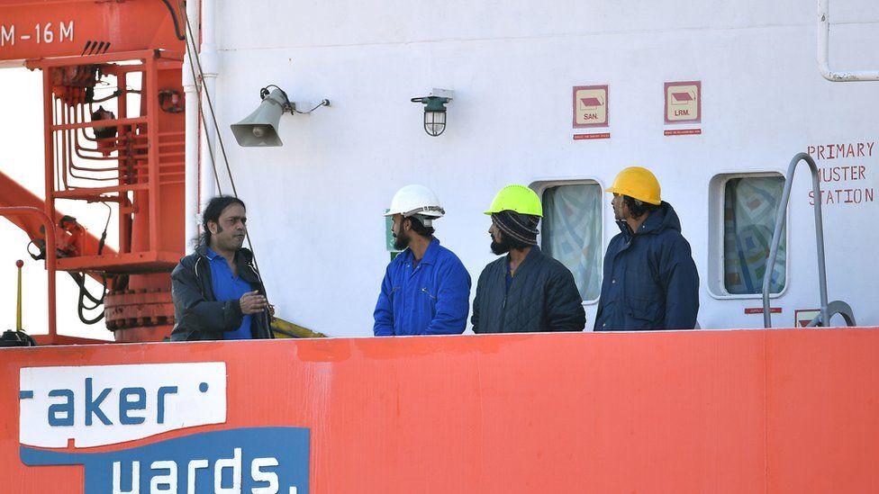 Captain Nikesh Rastogi, from Mumbai, (left) with his crewmates