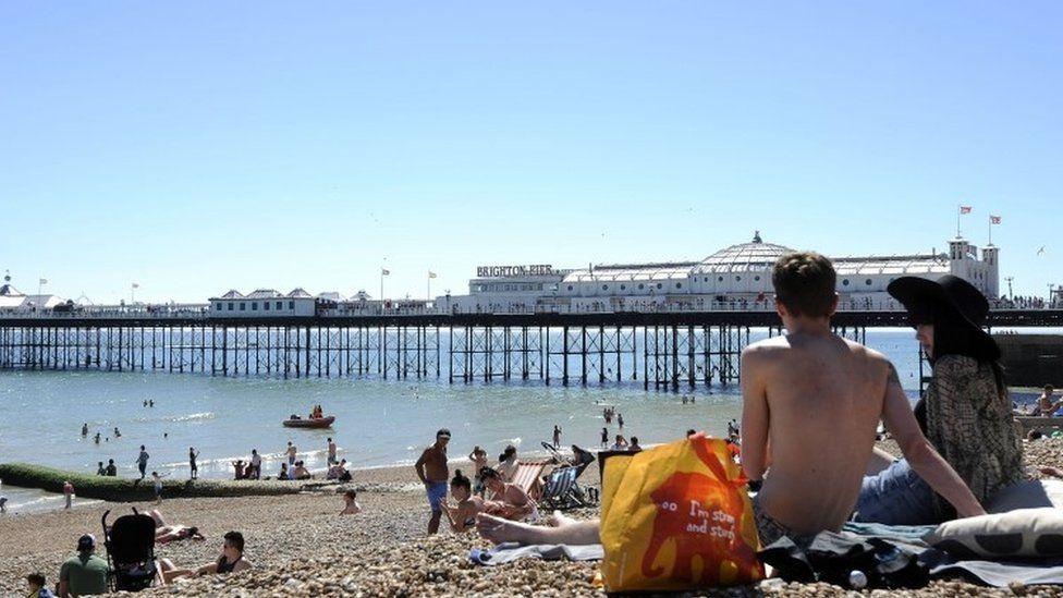People sitting on Brighton beach
