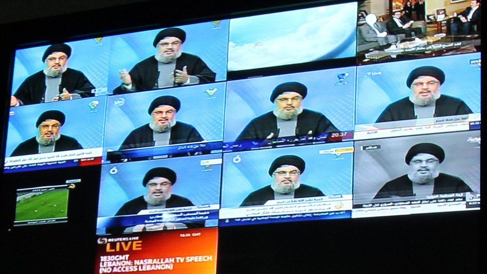 Lebanon's Hezbollah chief Hassan Nasrallah is seen on broadcast screens at Hezbollah owned al-Manar TV in Beirut during his speech on January 16, 2010.