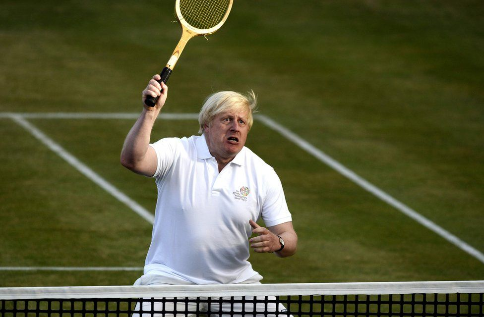 This file photo taken on June 16, 2013 shows Mayor of London Boris Johnson hits a shot during a celebrity tennis match in aid of The Royal Marsden Cancer Charity at the Queen's Club in west London on June 16, 2013