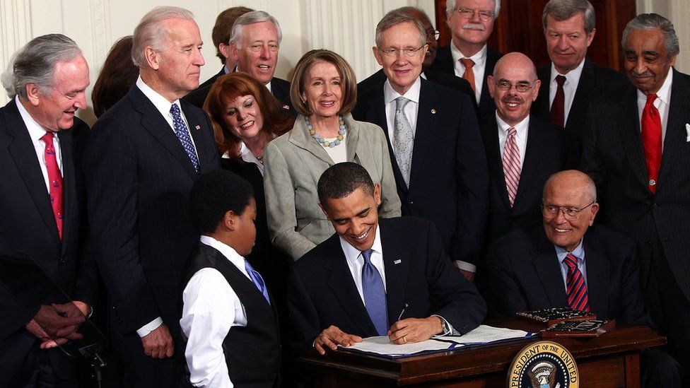 President Barack Obama signs the Patient Protection and Affordable Care Act into law in 2010