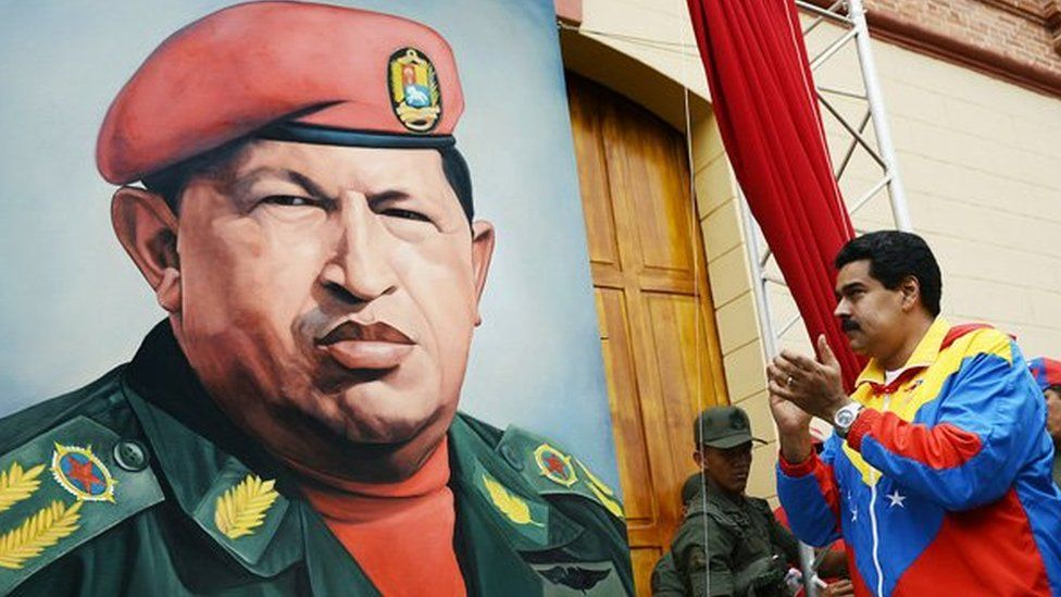 Nicolas Maduro stands by a portrait of Hugo Chavez on 4 February, 2013.