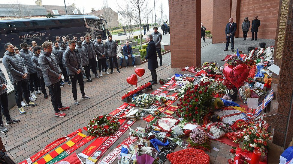 Jurgen Klopp and Liverpool players stand in tribute at the Hillsborough memorial