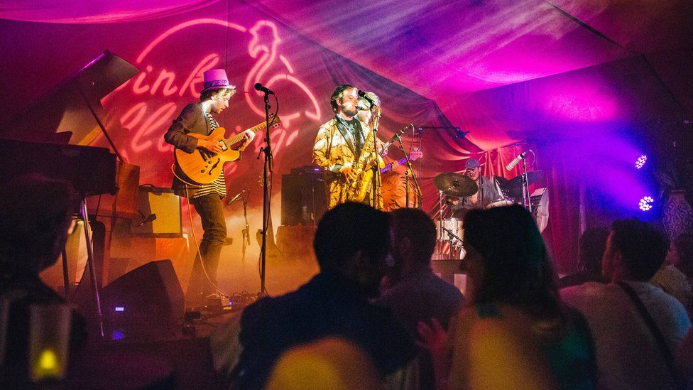 Musicians performing on stage at the Pink Flamingo Jazz club at Shambala Festival