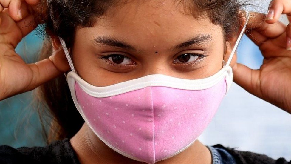 A girl wears a mask in Bangalore, India. Photo: 16 September 2020