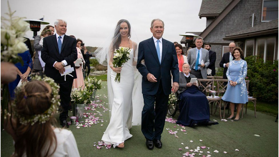 Former President George W Bush walks his daughter down the aisle