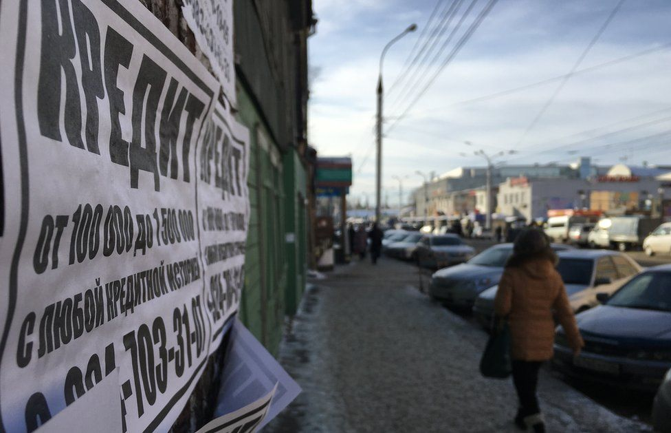 Flyers are daubed on walls on Irkutsk promising cheap credit