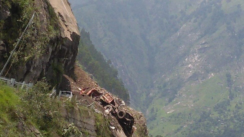 A truck hit by a landslide