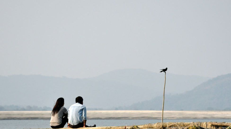 A representational photo of a couple at a beach in India.