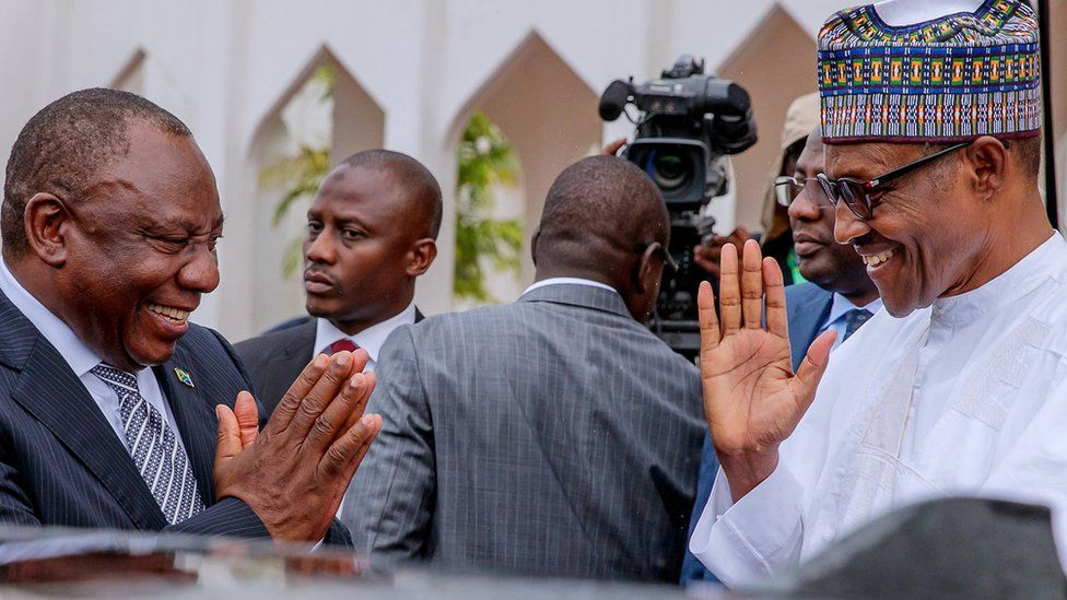 South African President Cyril Ramaphosa (L) and Nigerian President Muhammadu Buhari (R) greet each other at State House in Abuja, Nigeria - Wednesday 11 July 2018