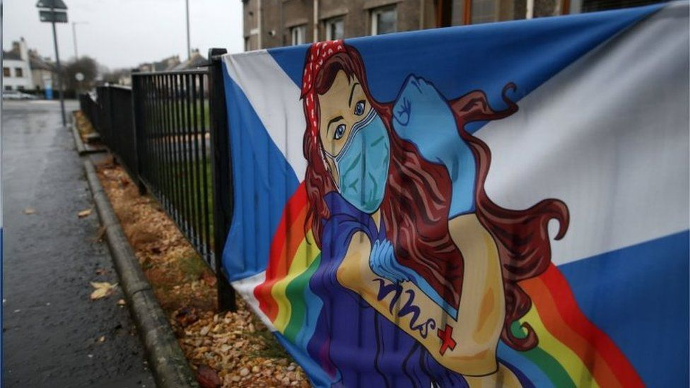 A Saltire flag with an NHS supporting cartoon