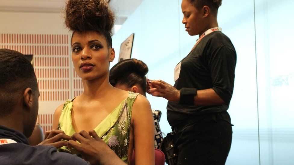 Models getting ready backstage