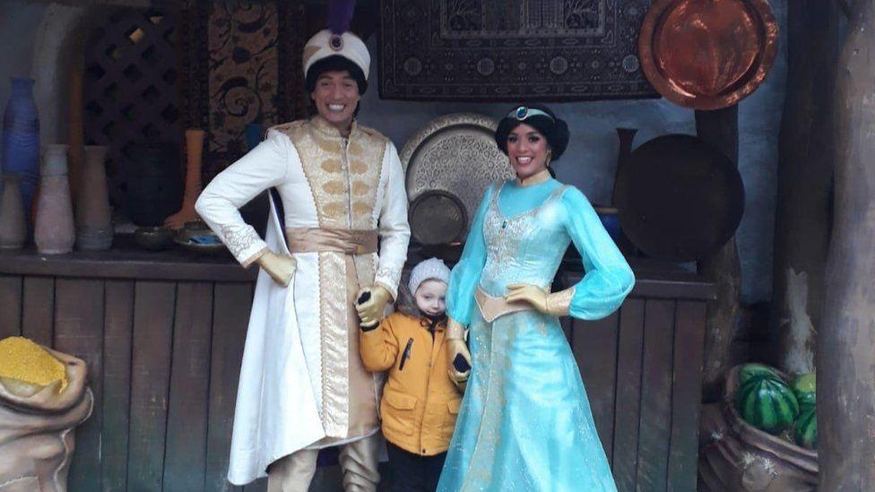 Aladdin and Jasmine with boy