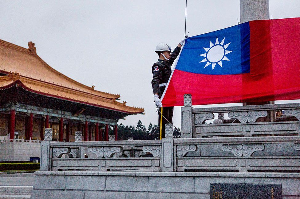 Honour guards prepare to raise the Taiwan flag in the Chiang Kai-shek Memorial Hall square ahead of the Taiwanese presidential election on 14 January 2016 in Taipei, Taiwan