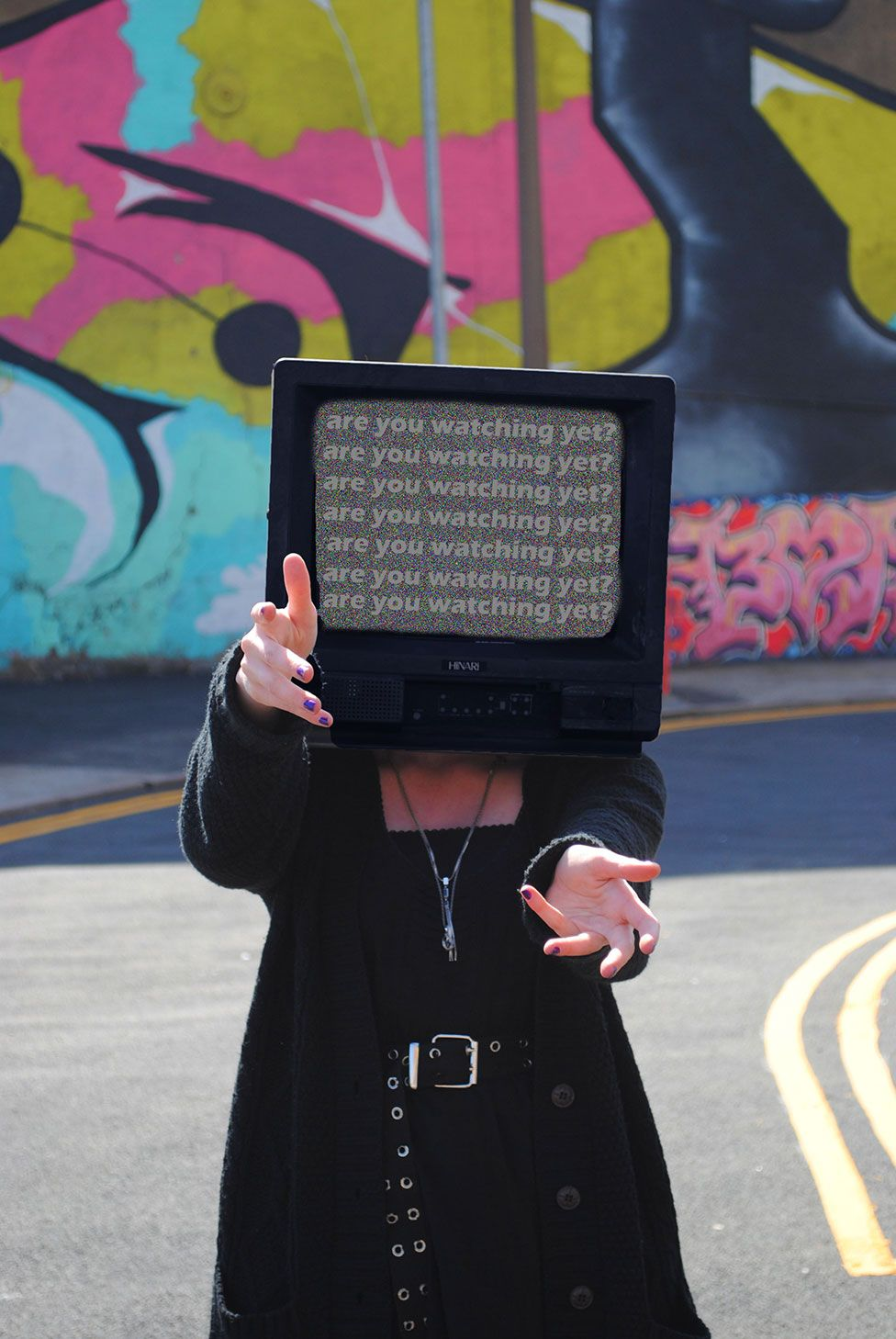 A piece of art showing a photo of a woman with a television set for a head