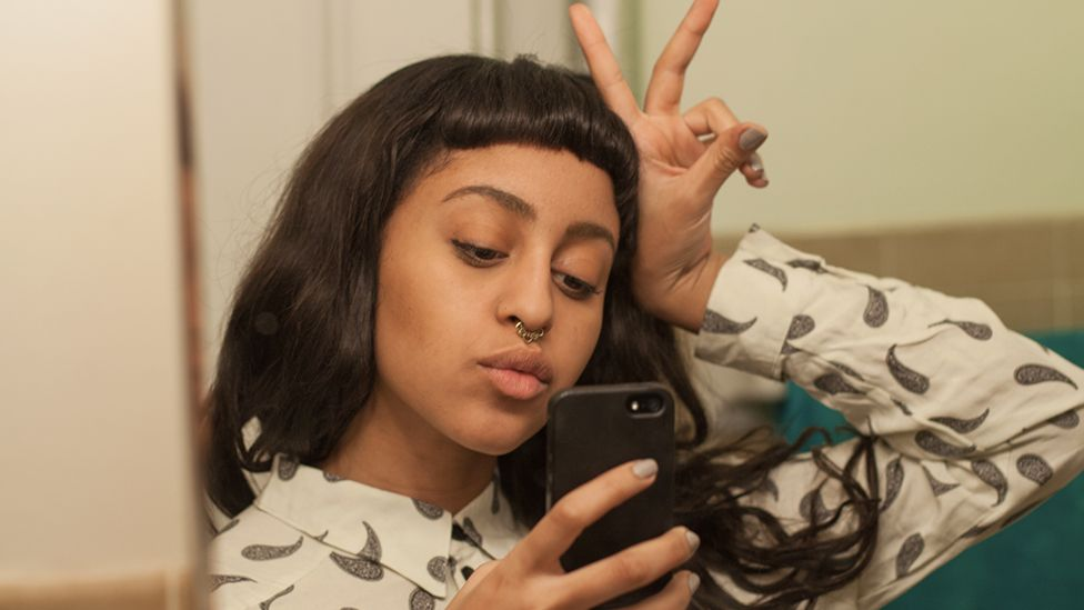 Girl posing in the mirror