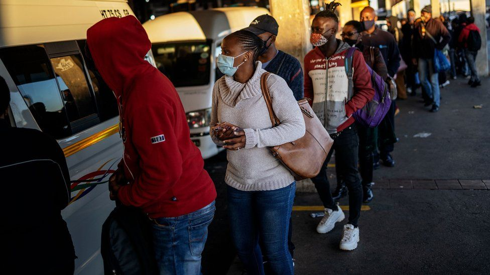 Commuters queue to use buses to work