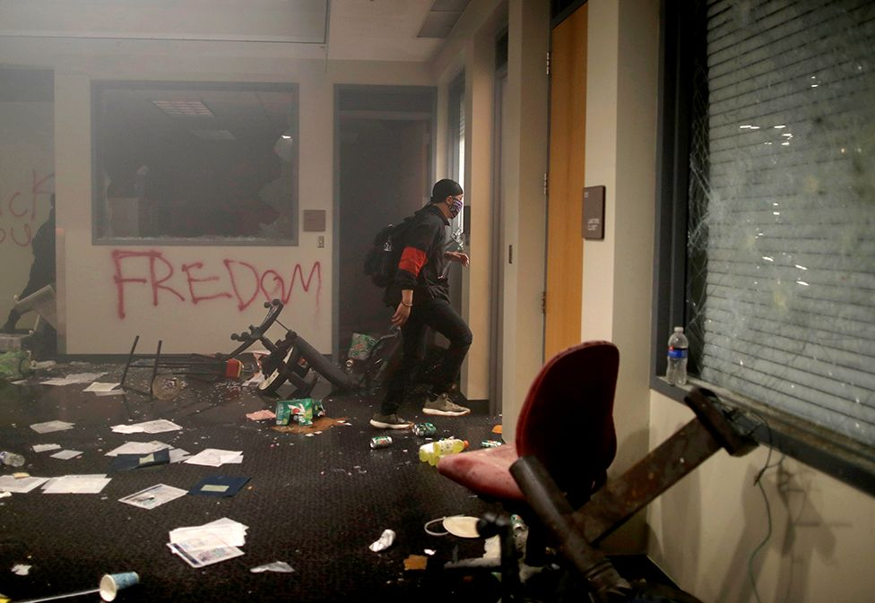 Protesters are seen inside Minneapolis Police third precinct