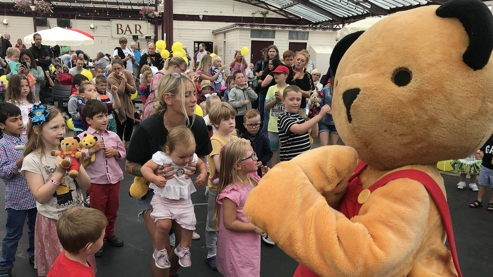 Sooty mascot with children